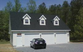 Custom three car Garage with three dormers