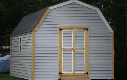 Shed 12x14 with white vinyl siding